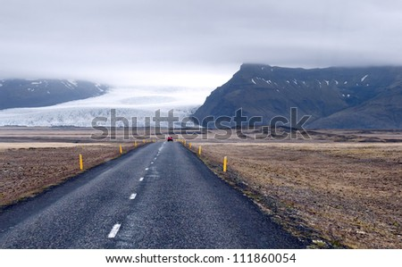 The road leading around the glacier fields in the mountains, Iceland