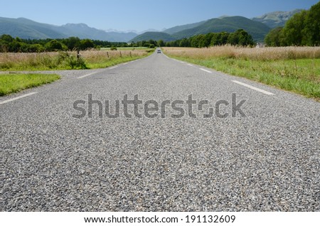 The road surface is photographed close-up with diminishing perspective.