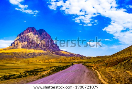The road through the valley to the mountain top. Mountain valley road landscape. Road in mountain valley