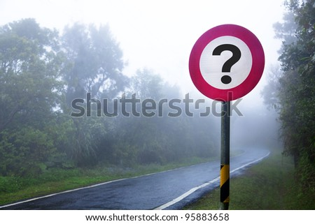The road to the fog forest and question sign