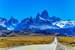 The road to the mountains. The border area between Argentina and Chile. Highway through the desert Patagonia goes to the magnificent mountain range Fitzroy. The concept of extreme, active tourism