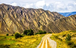 The road to the mountains through the valley. Mountain road. Road in mountains. Mountain landscape