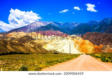 The road to the mountains through the valley. Road in mountains. Mountain road landscape. Mountain landscape