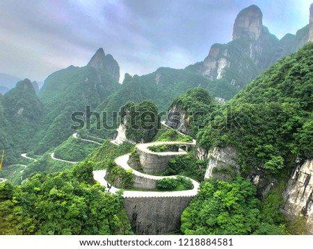 The road way in Tianmen Mountain National Park are devious. It is amazing street in the China, Asia. Limestone mountains are green. The sky are beauty. It's popular travel place in the world. Stock fotó ©