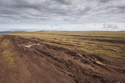 The road with mud and puddles in the fields, off-road