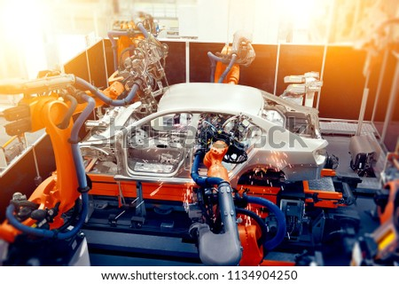 The robotic arm on the car production line is working