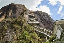 The Rock of Guatape, El Penon de Guatape, also La Piedra or El Penol, is a landmark inselberg also known as The Stone of El Penol, La Piedra del Penol in Colombia with a long staircase to the top