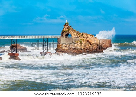 The rock of the Virgin or Le rocher de la Vierge is a tourist natural landmark in Biarritz city in France Photo stock ©