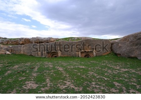 The rock tombs, carved in the lime stone quarry in the Dara ancient site. The focus is on the rock tombs.  Stock fotó ©