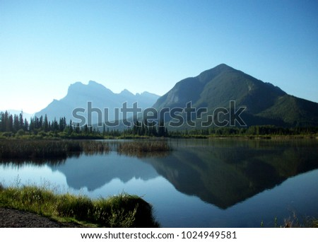 The Rockies mountains in Canada, clear  reflection in the lake #1024949581