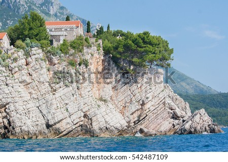 the rocks above the water and the old houses of the island of Sveti Stefan Montenegro