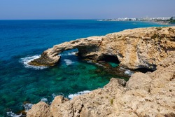 The rocky coast and the Mediterranean Sea of Cyprus. Rock in the form of an arch.