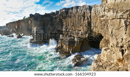 The rocky coastline  of Cascais is famous for the cave named, The jaws of the devil or The gates of hell, Portugal.