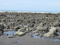 The rocky end of Oakura Beach, New Plymouth, New Zealand
