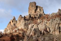 The rocky hill. Eroded rocks. Wind erosion. Nature landscape background.