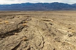The rocky valley floor shows signs of flash floods in this wash in Death Valley National Park, California