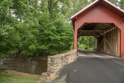 The Roddy Road red covered bridge carries local trafffic over a stream. It is located near Thurmont in Frederick County MD