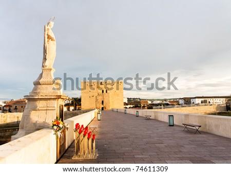 The Roman Bridge and the Calahorra Tower on the guadalquivir river in Cordoba, Spain