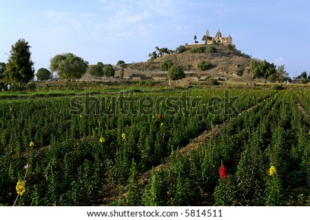 The Roman Catholic church of Nuestra Senora de los Remedios overlooks the town of Cholula from atop the Great Pyramid.