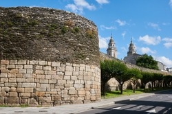 The Roman walll and the towers of the cathedral of Lugo in Galicia, Spain
