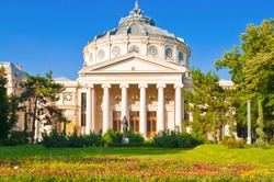 The Romanian Athenaeum - beautiful concert hall in Bucharest, Romania and a symbol of the Romanian capital city. The evening light increases the beauty of the building.