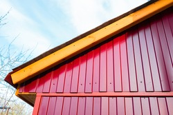 The roof of a private house. Metal shed. Home construction. Construction. Construction Materials. The facade of the house.
