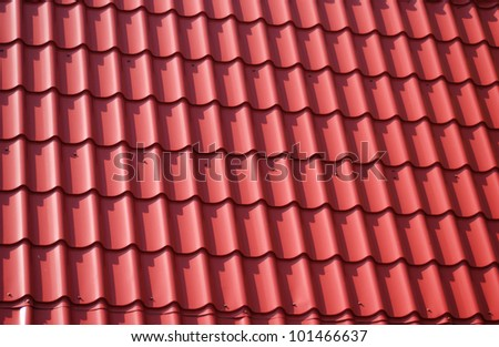 The roof of red tiles laid out
