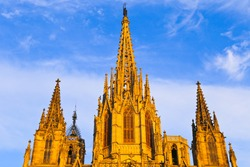 the roof of the Barcelona Cathedral, which is golden in the sunset.