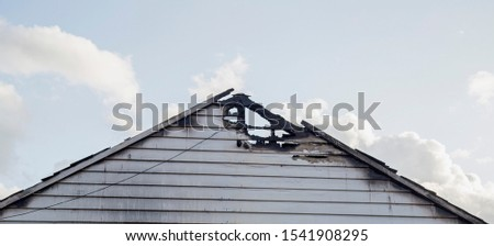 The roof timbers of a burned out historic timber building