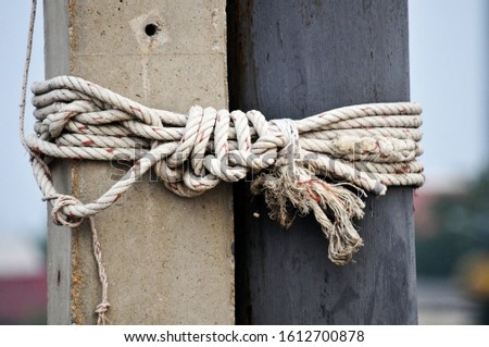 The rope is used to tie the pole to tie the pole to the boat.