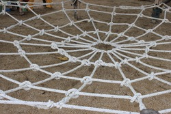 The ropes that were tied together like a spider web for children to play.