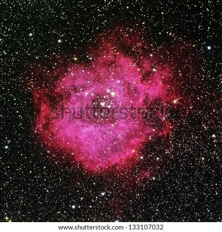 Stock Photo The Rosette Nebula is a large cloud of glowing gas approximately 130 light years accross surrounding a cluster of young stars in the constellation Monoceros