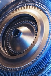 The rotor disk with the blades of a turbojet gas turbine engine with a blue glow. Elements, parts and mechanisms of turbines. Energy and mechanical engineering, square frame