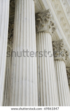 The rows of classical columns with portico. Supreme court building in Washington, DC #69861847