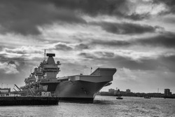 The Royal Navy aircraft carrier HMS Queen Elizabeth (RO8) docked in Portsmouth, UK