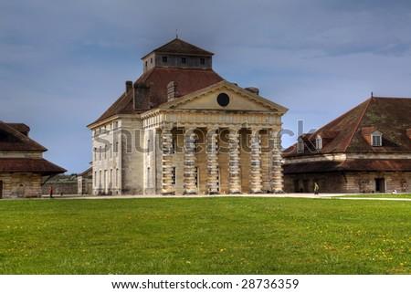 The Royal Salt Works (Saline Royale - UNESCO World Heritage Site) of Arc-et-Senans, France (HDR image) - stock photo