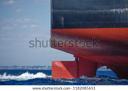 The rudder of a large ship steers it on a steady course #1182085651