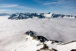 The Rugged and Icy Peaks of The North Cascades Peirce Through the Clouds. North Cascades National Park, Washington
