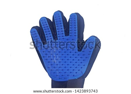 The rugged rubber gloves ,Gloves, brush the cat hair Isolated on white background.