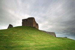 The ruin of Duffus Castle perched on a grassy mound. Near Elgin, Moray, Scotland