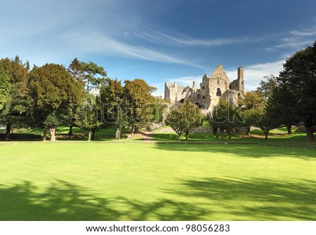 The ruin of 13th century Dirleton Castle and gardens on a sunny day, Dirleton, East Lothian - stock photo