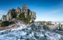 The ruined chapel built in to a craggy outcrop of granite at Roche Rock in Cornwall