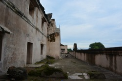 the ruins inthe cultural heritage complex of Taman Sari Water Castle, an archaelogical site in the middle of yogyakarta city, many of which have not been repaired since 1812  because of british attack