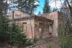 the ruins of an abandoned and dilapidated building in the forest