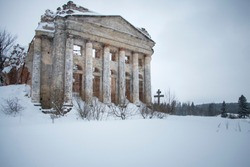 The ruins of an abandoned Russian church in snow in a village near St. Petersburg on a winter day.