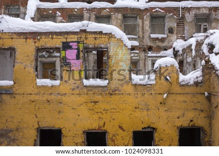 The ruins of an old brick house covered with snow. Melnitsky Lane, Moscow, Russia.