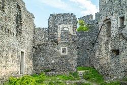 the ruins of an old castle overgrown with grass. Nevytskyi castle Uzhhorod.