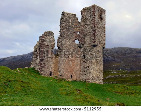 The ruins of Ardvrek Castle in the Assynt mountain range, highlands, Scotland.