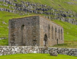 The ruins of St. Magnus Cathedral in Kirkjubøur (Kirkebø) a historical village on Streymoy, Faroe Islands. The ruins are the largest medieval building in the Faroe Islands.