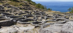 The ruins of the ancient Celtic village by the sea in Santa Tecla, Galicia, Spain
